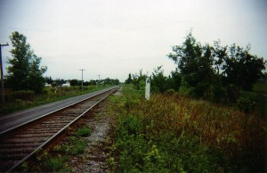 Looking south to Toll Gate Road, Cornwall, 1999.  Original whistle post still erected by the rails.